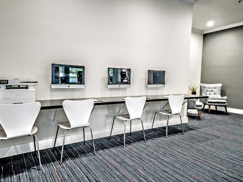 This image shows high technology and faster innovation of TGM Andover Park for having a computer bar for community amenities that's ideal for everyone.