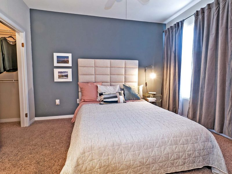 This image is a Premium Apartment Feature that displays the bedroom area with loft options and high ceiling construction.