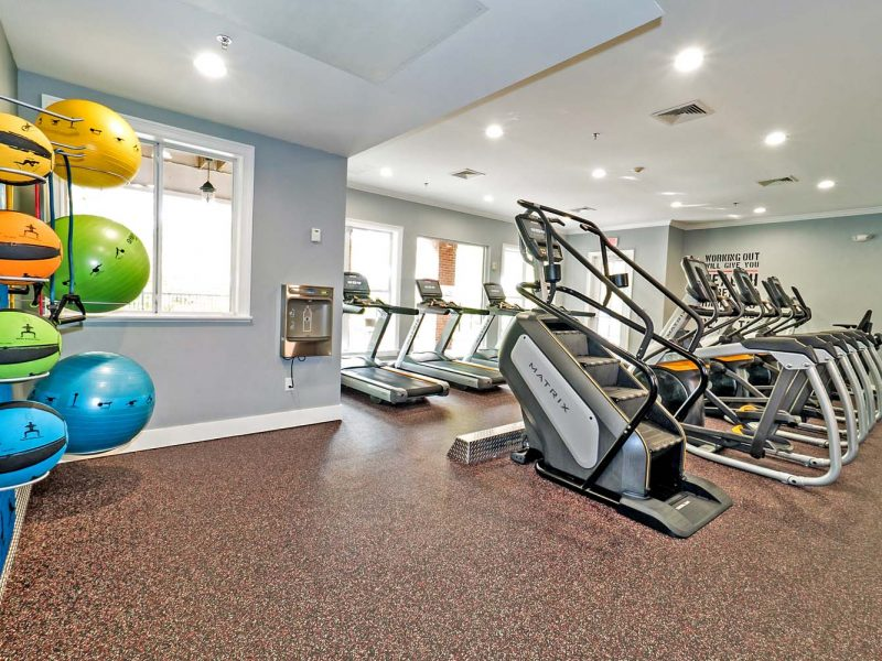 This image showcases commercial fitness with State-of-the-art 2-level athletic club with Matrix Series 7xi equipment that is essential for community amenities. It offers a different weight of kettlebells that is good for point gravity off-centered.