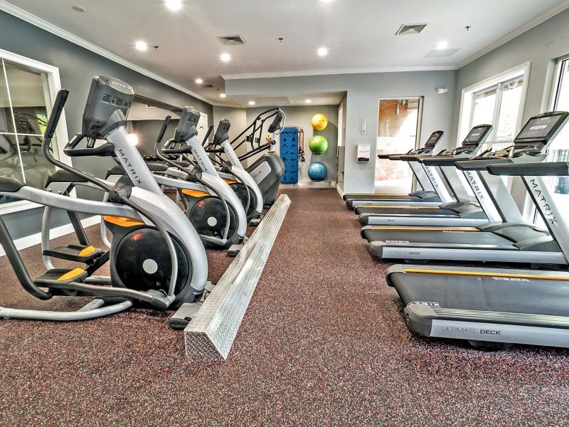 This image showcases commercial fitness with a State-of-the-art 2-level athletic club with Matrix Series 7xi equipment that is essential for community amenities and offering an indoor cycle.