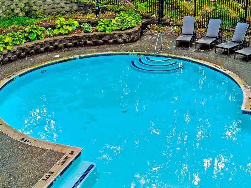 This image shows the resort-style outdoor swimming pool with grill area.